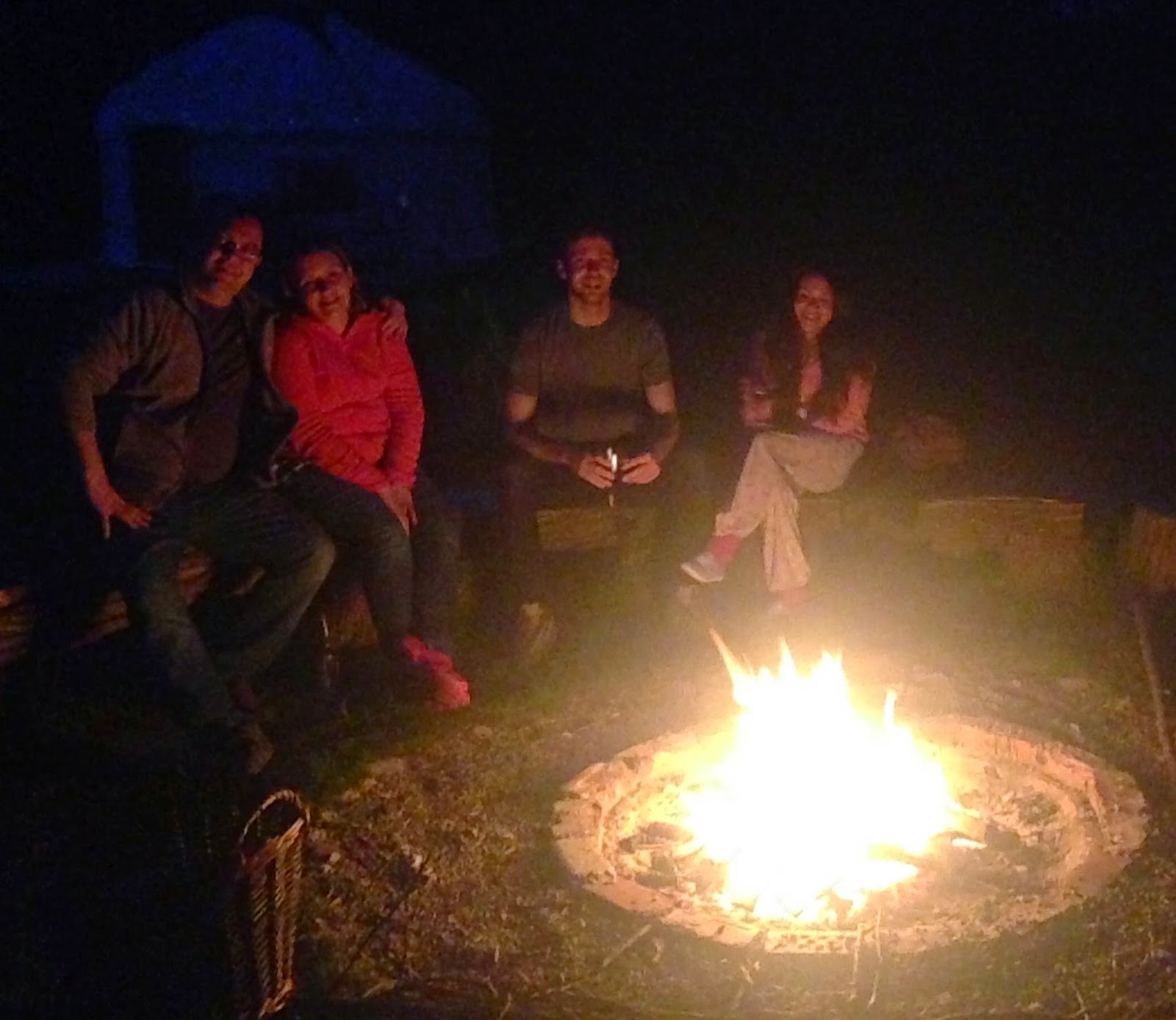 Acorn glade group around fire