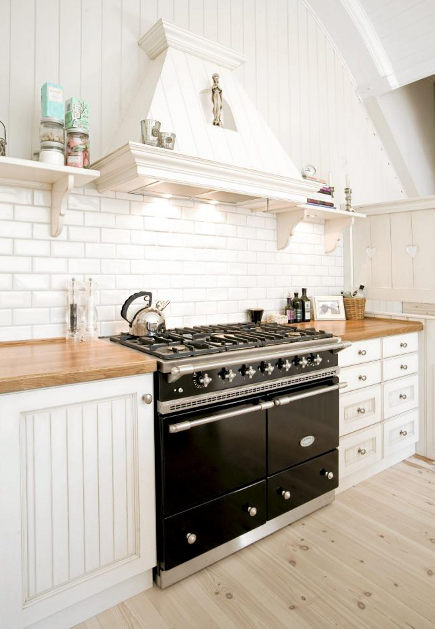 White kitchen with LaCanche black range/stove