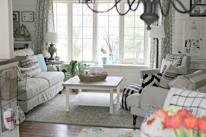Birch Lane Montgomery sofa, Ikea hack Hemnes coffee table, Ikea Stocksund and Jennylund chairs  in living room with plank walls - www.goldenboysandme.com