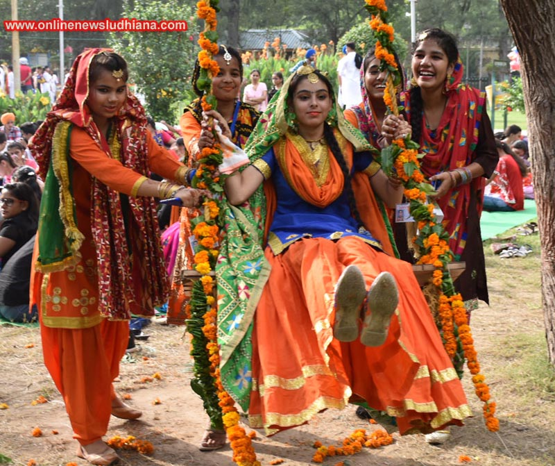 Girls enjoy swing during Teej Festival organised by Hero Cycles at O P Munjal Rakhbagh in Ludhiana