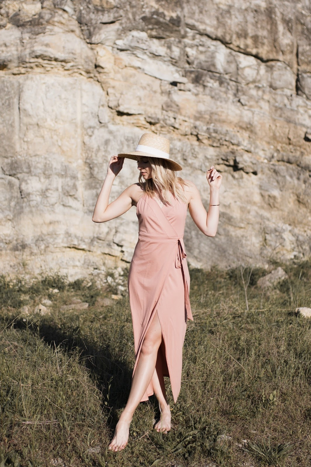 pink wrap dress with a straw hat