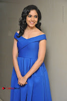 Actress Ritu Varma Pos in Blue Short Dress at Keshava Telugu Movie Audio Launch .COM 0034.jpg