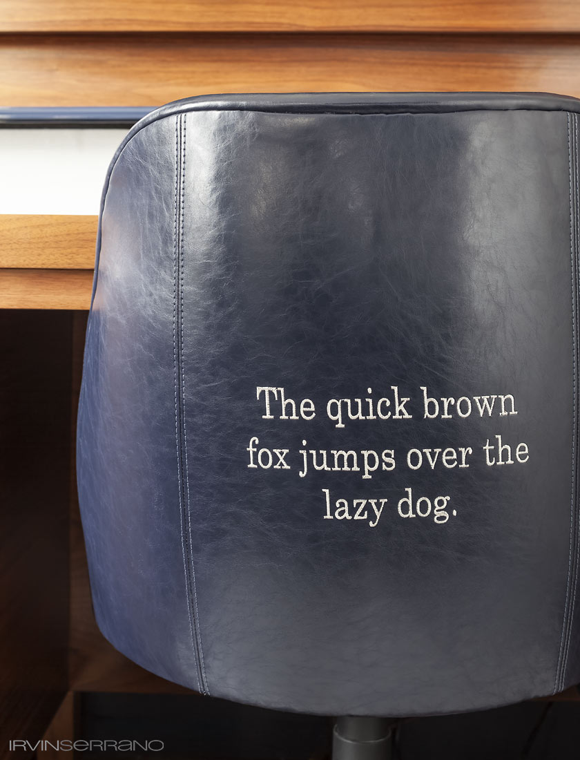 The quick brown fox jumps over the lazy dog, a phrase that uses all letters in the alphabet, is embroidered into a writers chair in a guestroom at the Press Hotel in Portland, Maine.