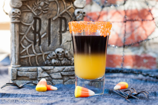 black vodka, orange juice, layered shot, halloween cocktail