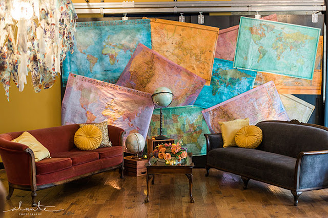 map wall with couches