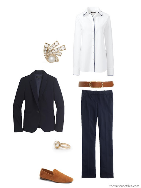navy suit and white shirt with brown leather accessories