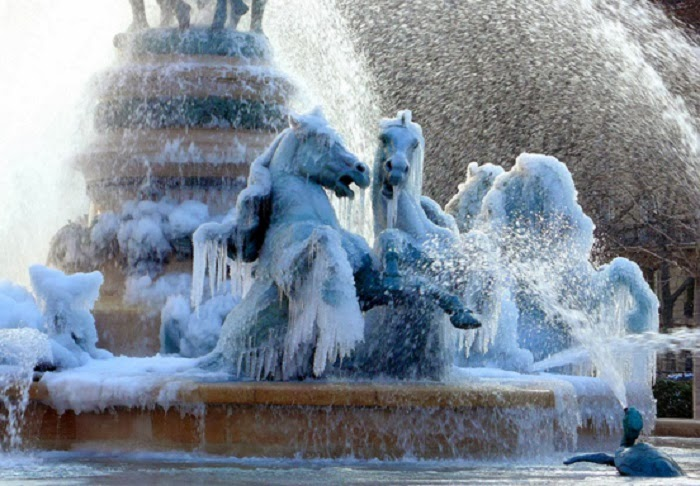 Paris, France. - Winter Blast Transforms Water Fountains Into Magical Ice Sculptures