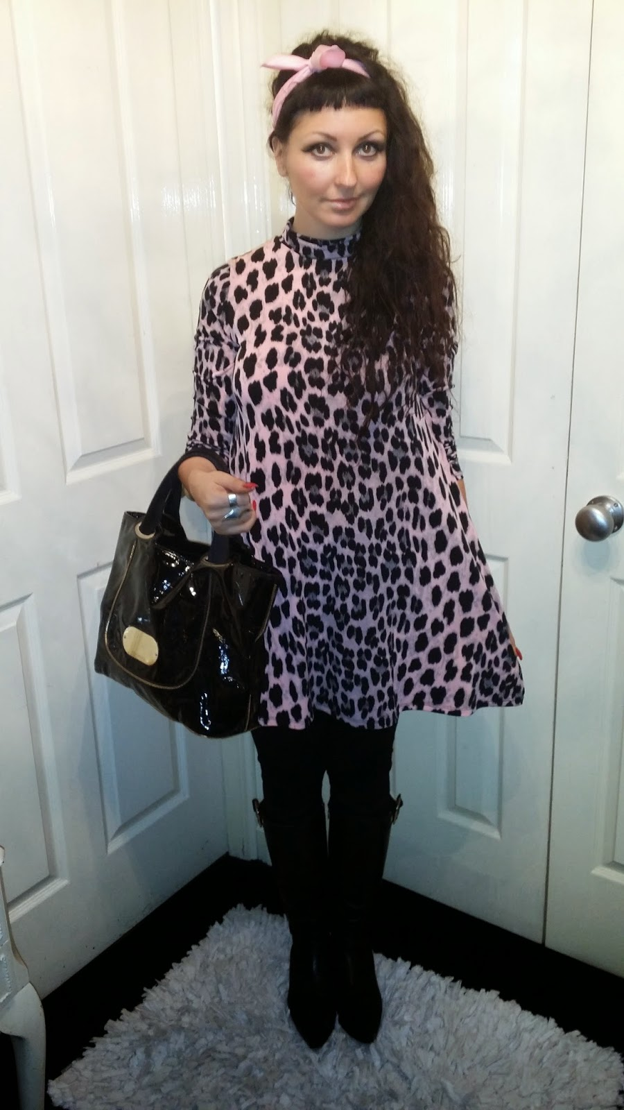 8b398b7eff I wore this for a day in the office which consists of my Giorgio Armani bag  which I wore with this animal print runic...Black leggings and Prada boot s.
