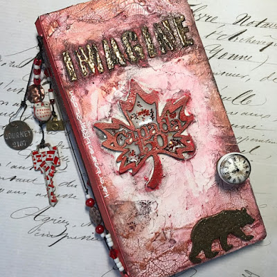 Cover of a travel journal Canada 150 chipboard, lots of texture, red & white