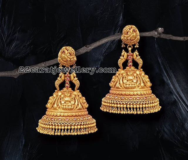 Gold Jhumkas and Diamond Earrings