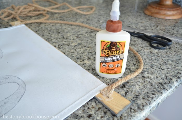 Gluing scroll sign together