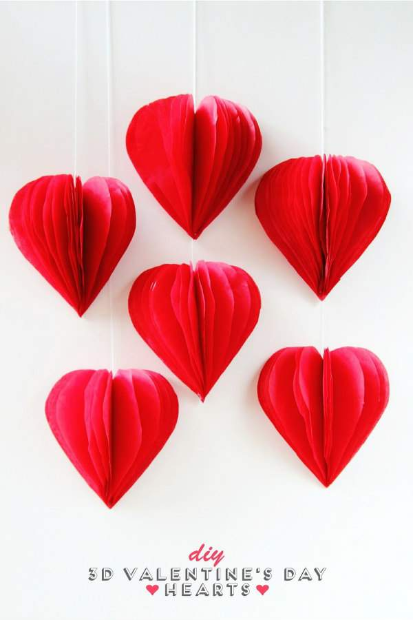 3D Red Tissue Paper Hearts on wall