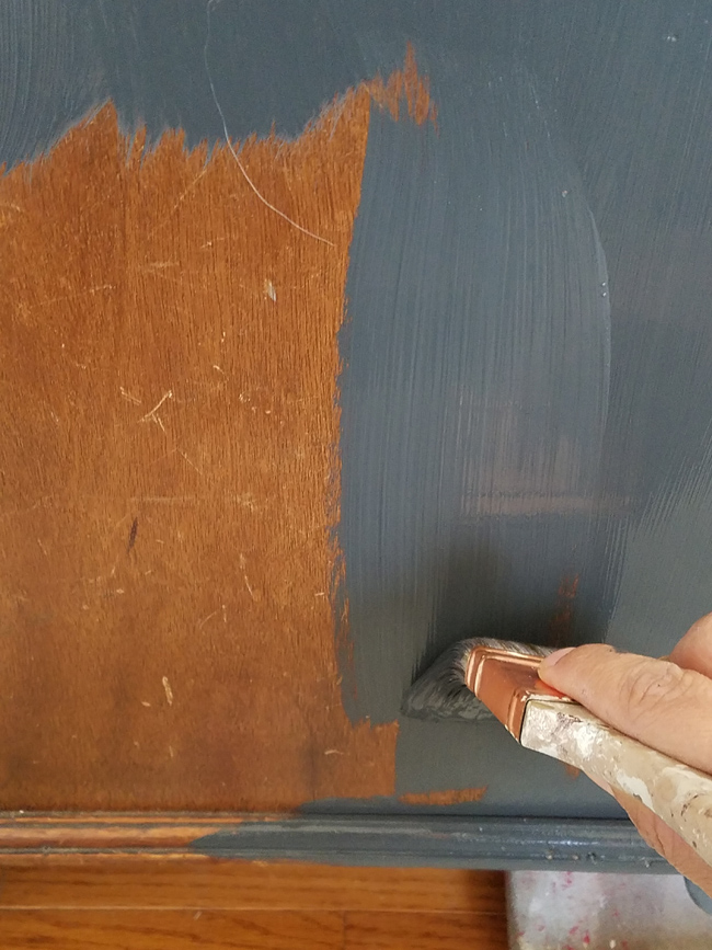 applying chalk paint with brush