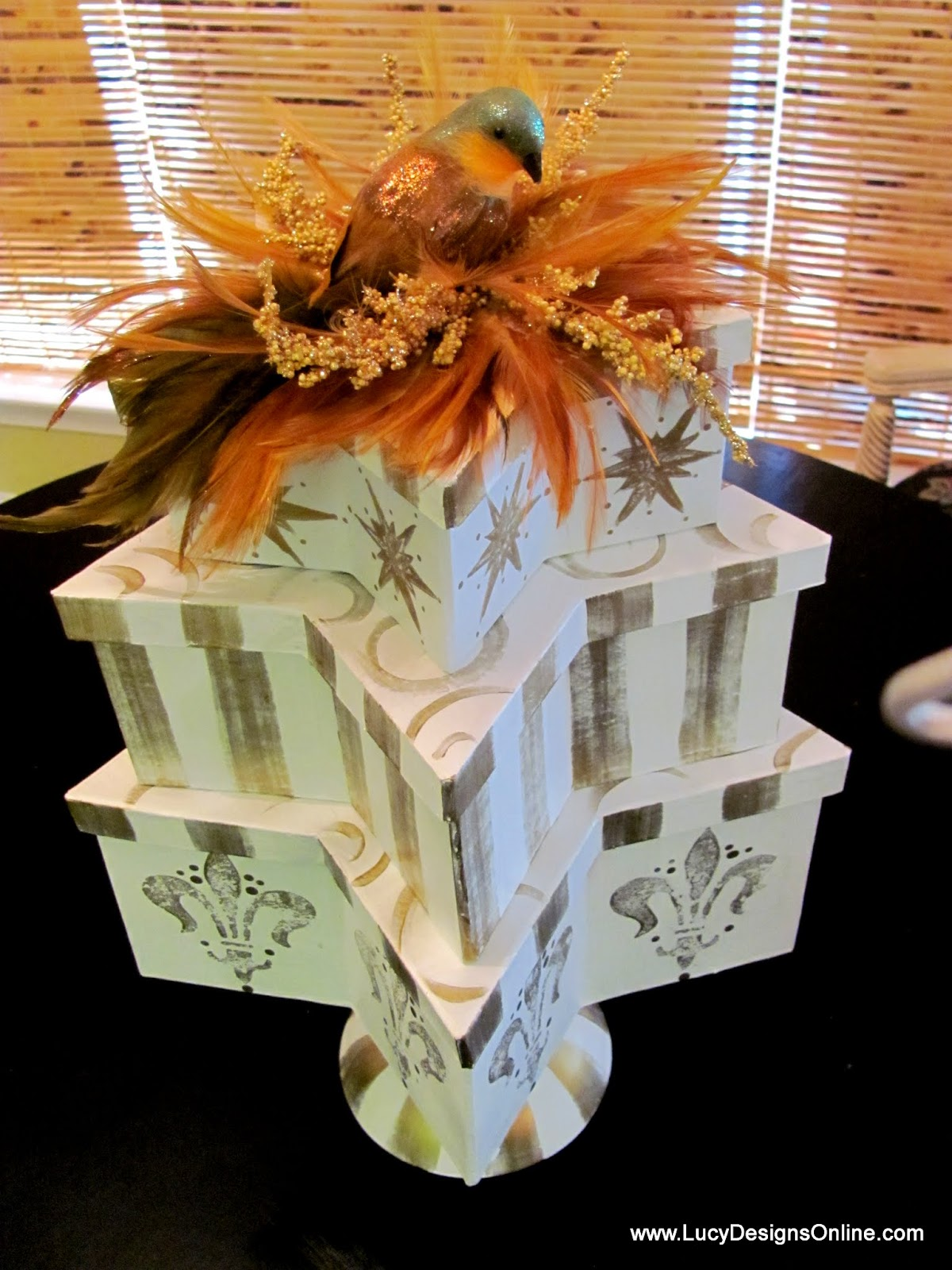 stacked gift box topiaries with birds and feathers