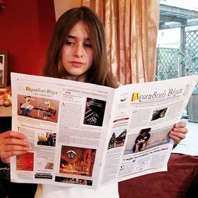 * ανάγνωση εφημερίδας *