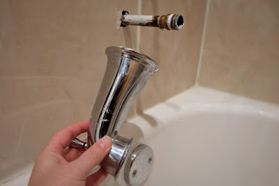 remove tub filler