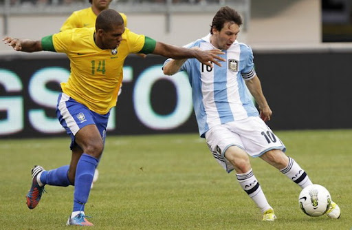 Argentina forward Lionel Messi shoots to score his third goal against Brazil