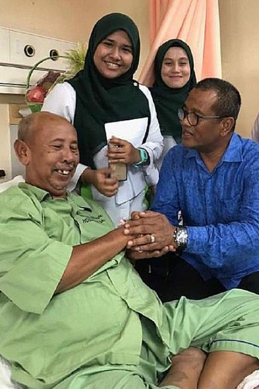 Zaibo with visitors after he was warded in the Sungai Buloh Hospital earlier this month.