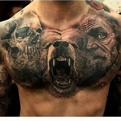 Tatuaje en el pecho de calavera, oso y cazador