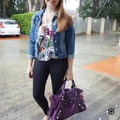 awayfromblue instagram double denim jacket skinny jeans floral ruffle cami purple balenciaga work bag