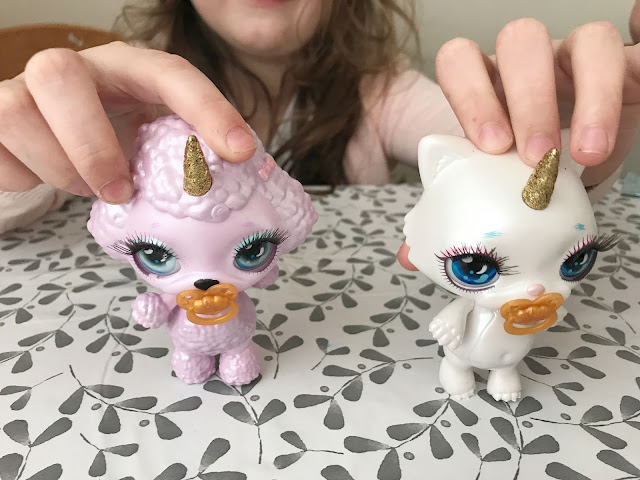 two poopsie sparkly critter toys