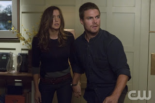 "Stephen Amell and Katie Cassidy as Oliver Queen and Laurel Lance in Arrow Episode # 2 ""Honor Thy Father"""