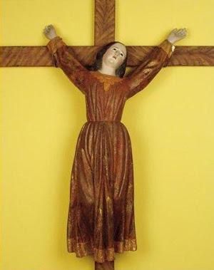 En la imagen se muestra a Santa Librada, crucificada por orden de su padre.