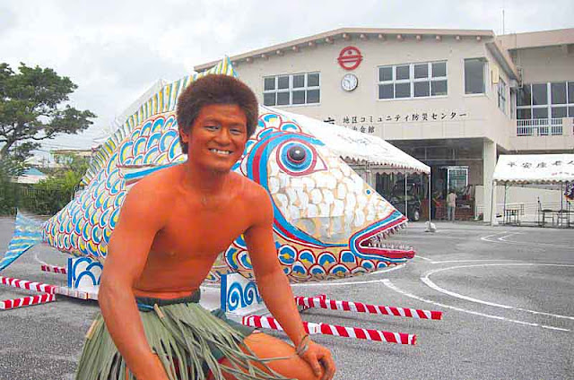 orange body, young man, Kijimuna, grass skirt, fish, village office