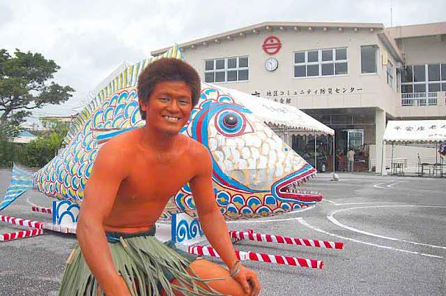 orange body, young man, Kijimuna, grass skirt, fish, village office