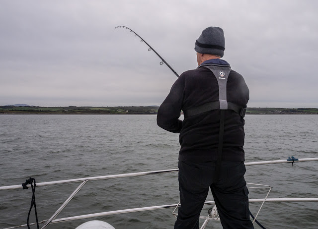 Photo of Phil fishing on Ravensdale's foredeck