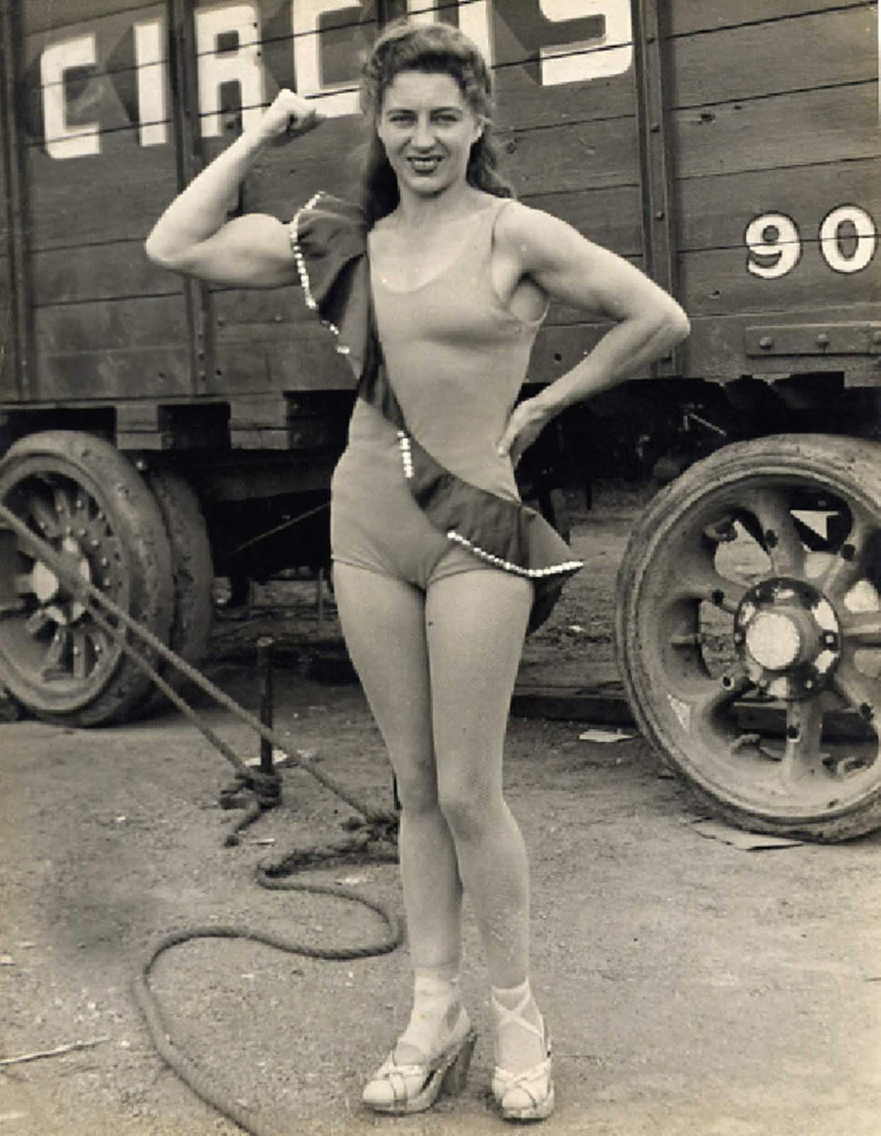 Another vintage circus 'strong woman' flexing for the camera.