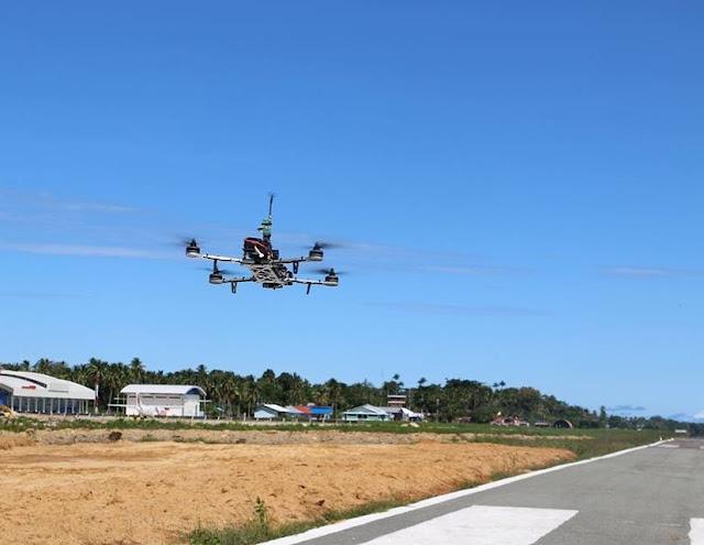 Drone Helicamindo terbang di Landas Pacu Bandar Udara Utarom Kaimana Papua Barat