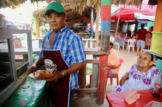 cochinita pibil stall at Holbox market, Yucatan, Mexico