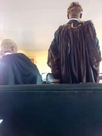 See Viral Photos Of A  Senior Lawyer Who Wears Torn Gown & Wig To Court