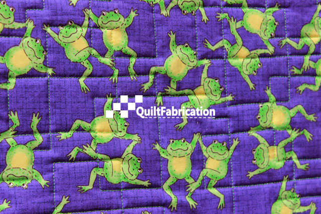 Open Sesame quilt backing of dancing frogs