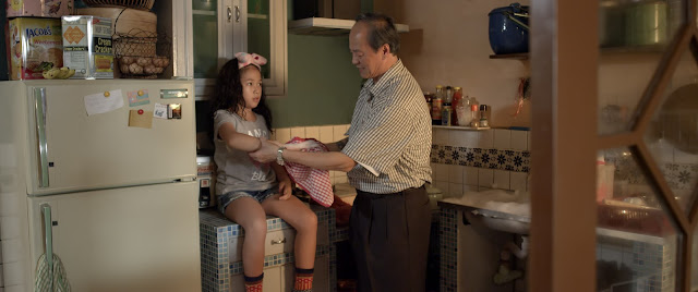 Grandpa Gen tending to Sarah's minor wounds