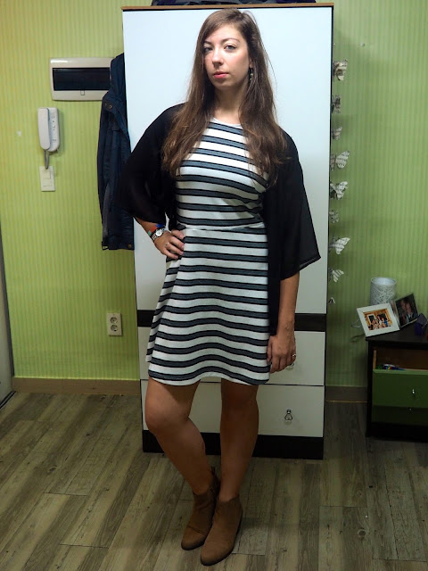 Sheer Fantasy   outfit of black and white striped skater dress, sheer black fabric cardigan, and brown suede heeled ankle boots