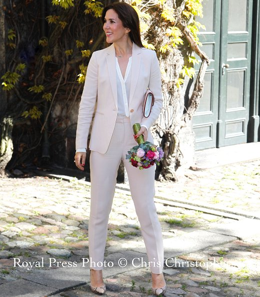 Crown Princess Mary wore beige Massimo Dutti pantSuit and Gianvito Rossi python pumps.