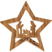 Estrella navideña tallada en madera con el Nacimiento