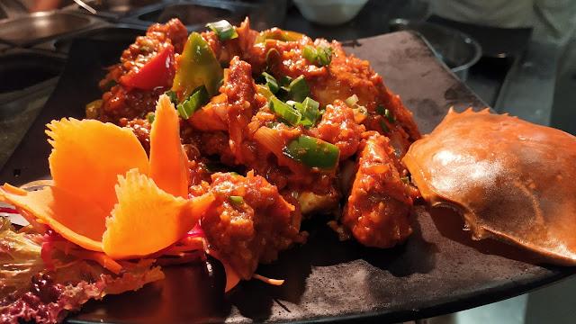 Crab Schezwan Sauce in garnished plate dinner ideas