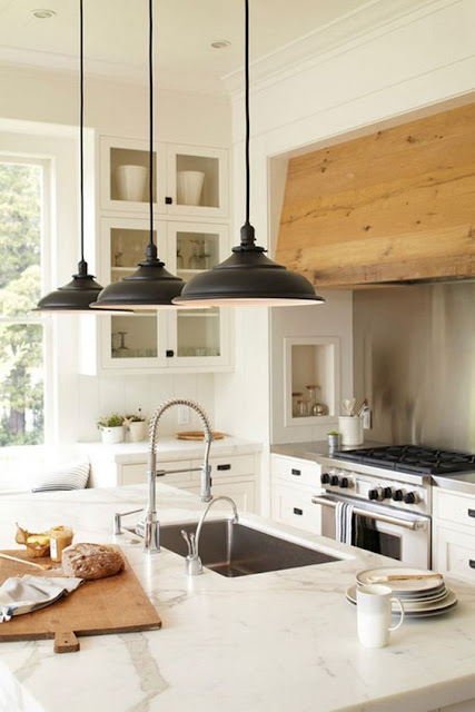 Modern farmhouse style kitchen with rustic range hood, white cabinets