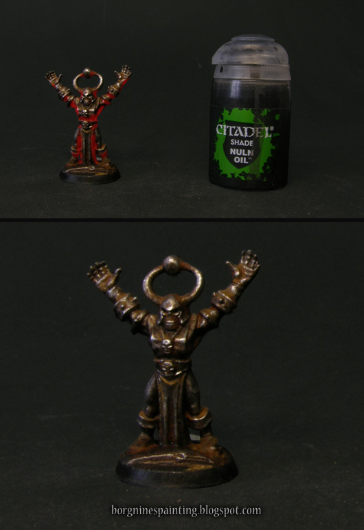 Photo showing the areas where the darkening shade should be applied, on the undersides of the miniature, with a soft, red overlay. A pot of Nuln Oil wash paint is visible on the right.