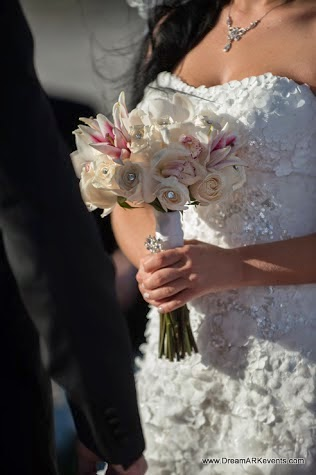 Bridal bouquet with roses, lily, orchids, crystals