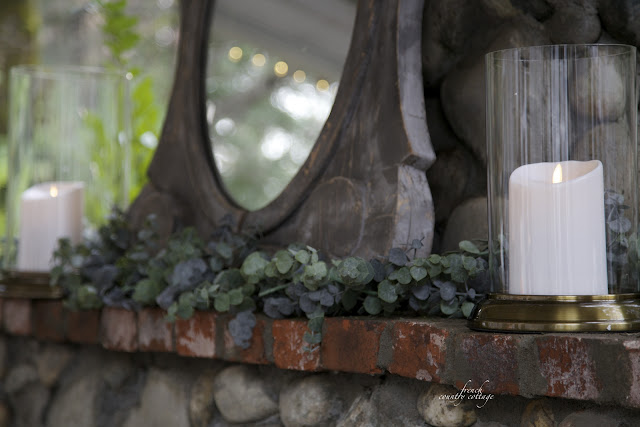 Outdoor fireplace with garland and candles