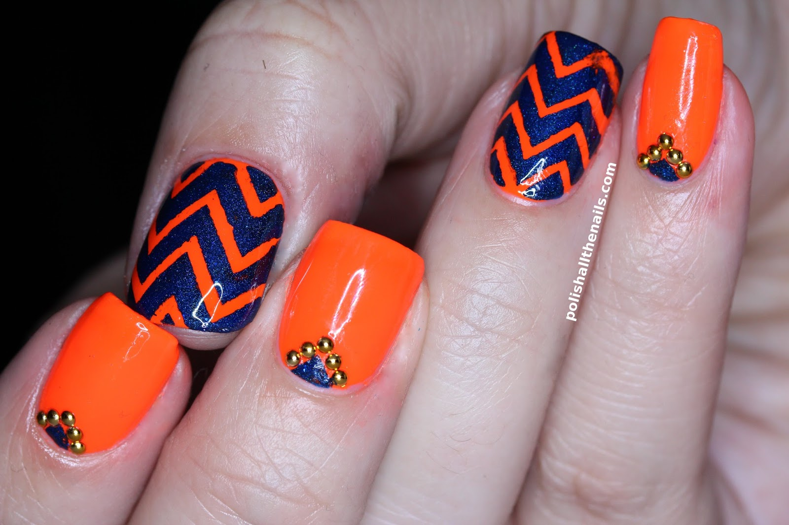 Nail Designs With Orange And Blue: Create a neon orange and dark ...