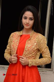 Telugu Actress Divya Nandini Stills in Orange Sleeveless Gown at Chennai Chaitrama Movie le Launch Event  0083.JPG