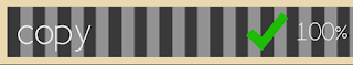 An achievement bar with black and grey vertical stripes with the word copy on the far left and a green check mark next to a numerically printed 100% on the far right.