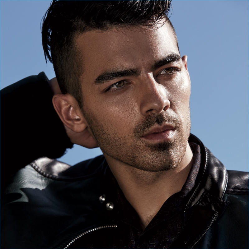 Joe Jonas wears a Fendi jacket with a Lanvin shirt