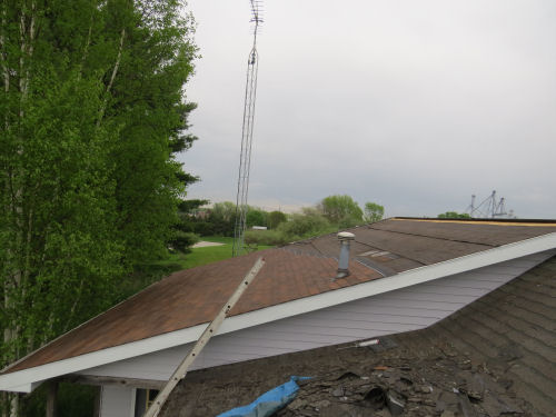 new shingles on half a roof
