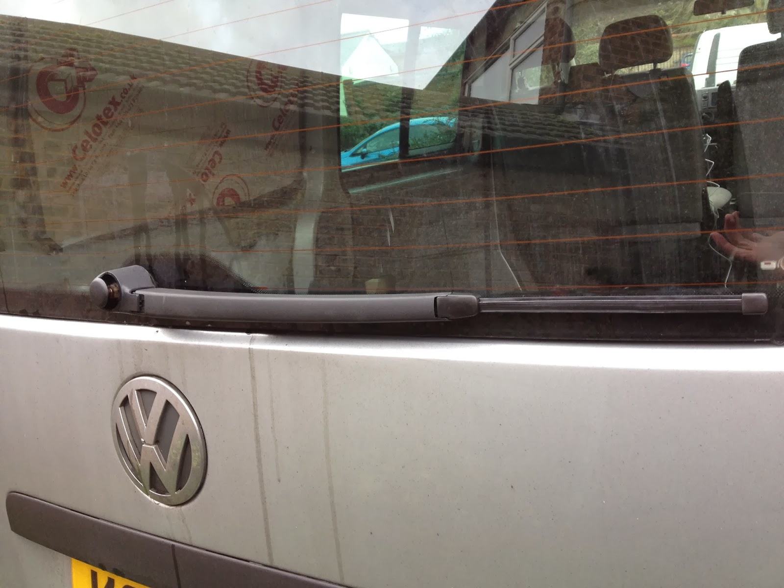 medium resolution of the photo on the left shows the new wiper arm in position